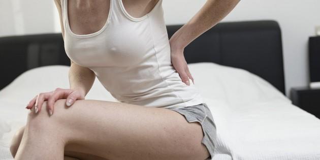 О чем говорит боль в пояснице на разных сроках беременности?